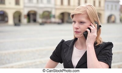 Businesswoman talking on the phone, eyelevel, neutral...