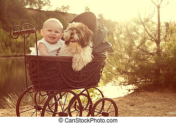 Baby girl and puppy are sitting in a vintage pram