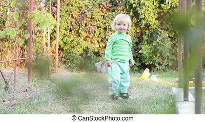 Runaway child - Girl in full growth runs and laughs