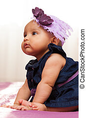 Adorable little african american baby girl looking - Black...