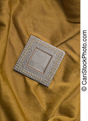 microprocessor detail vertical photo on golden fabric