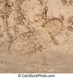 Shoe step left in the sand
