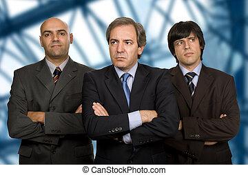 team of three business men standing pensive