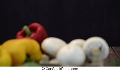 Vegetables on wooden box on wooden table background