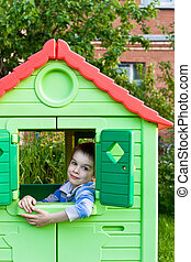 Boy in playground house