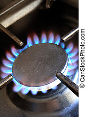 Lit gas cooker ring - Flames on the ring of a domestic gas...