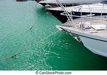Moored sailing boats - Bow of sailing boats moored in marina...