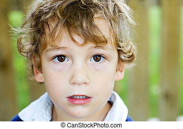 boy with big brown eyes - five year old boy with big brown...