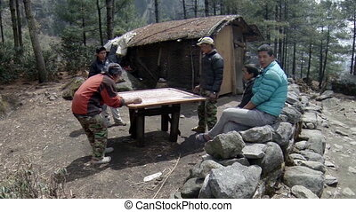 Nepalis playing a board game Carrom. Full HD
