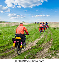 Travelling cyclists - Group of travelling cyclists crossing...