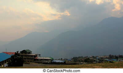 Timelapse sunset at the airport Lukla. Mountains Himalayas,...