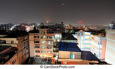 Buildings with flats at night, timelapse Kathmandu Nepal,...