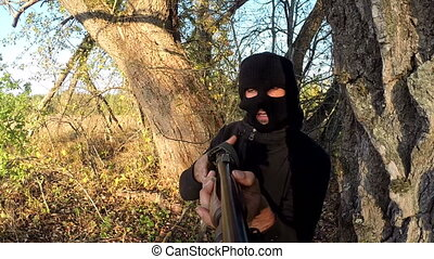 masked terrorist with a  gun