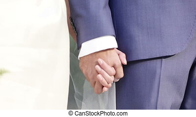 Hands newlywed - Bride and groom holding each others hands