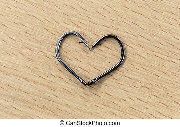 The black hooks placed heart symbols. - The black hooks...