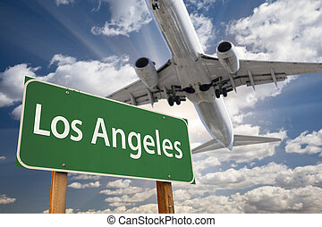 Los Angeles Green Road Sign and Airplane Above with Dramatic...