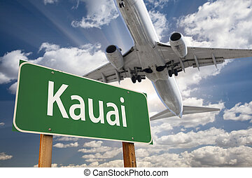 Kauai Green Road Sign and Airplane Above with Dramatic Blue...