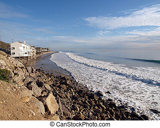 Pacific Homes - A row of beach houses in the warm California...