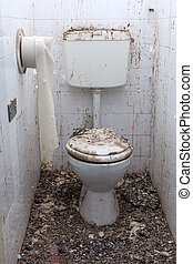 Dirty toilets in old abandoned home - Toilet in an...