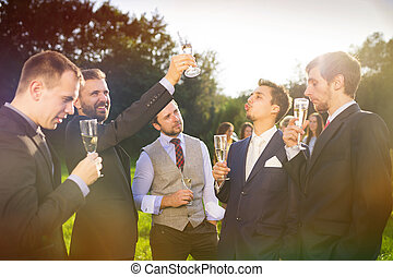 Groom with groomsmen - Groom with four happy groomsmen...