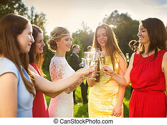 Bride with bridesmaids toasting - Bride with four happy...