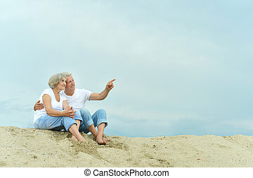 Amusing elderly couple - Amusing happy elderly couple on the...