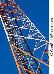 Communications tower with antennas on blue sky