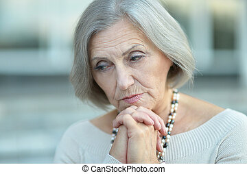 thinking elderly woman - Close-up portrait of elderly woman...