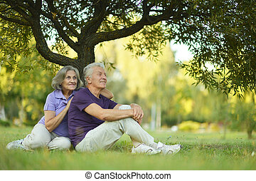 happy old people - Beautiful happy old people sitting in the...