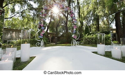 Decorated wedding arch candles