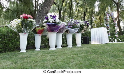 Wedding bouquets in vases - Camera trolley passes donated...