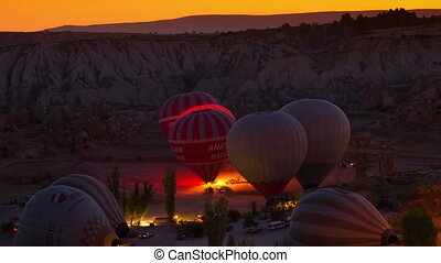GOREME - OCTOBER 12 TIME-LAPSE: Colorful hot air balloons...