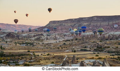 GOREME - OCTOBER 13 (TIME-LAPSE): Colorful hot air balloons...