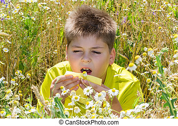 Boy with allergic rhinitis in meadow - Boy with allergic...