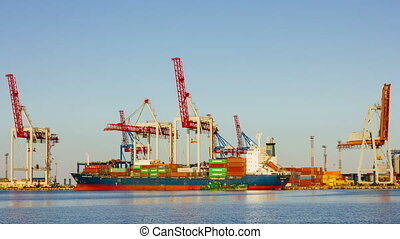 ODESSA - JUNE 30: (TIMELAPSE) Container cargo freight ship in shipyard with working cranes loading containers on June 30, 2014 in Odessa, Ukraine.