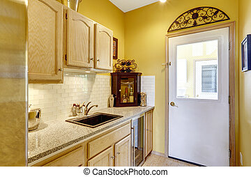 Small kitchen area with moden cabinets - Bright yellow small...
