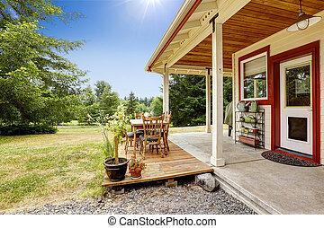 Farm house with patio area