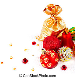 Red christmas ball and golden bag with gifts isolated on...