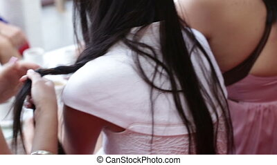 woman weaves a friend braid - caucasian woman weaves a...