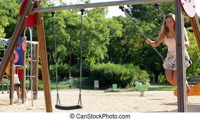 girl  on swing in park