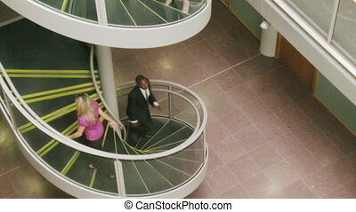 Business people going upstairs in High Definition - Vertical...