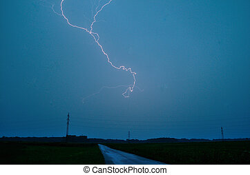 lightning and road - bright lightning in thunderstorms and...