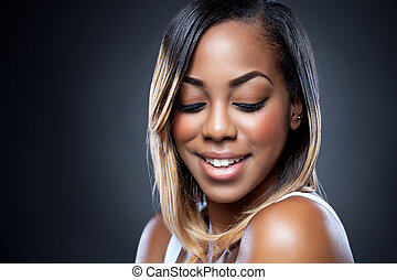 Young black beauty with perfect skin - Portrait of an young...