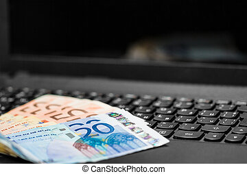 Money on keyboard of computer. Online banking.