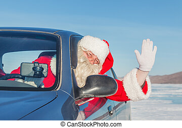 Portrait of Santa Claus in the car, shooting was conducted...