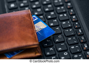 Wallet and card on keyboard. Online banking.