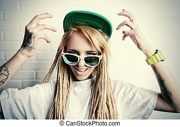 emotion - Modern teenage girl with blonde dreadlocks...