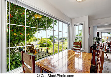 Bright dining area with large french window