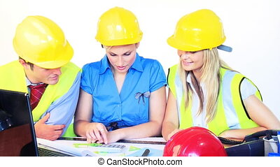Male and female architects working in office