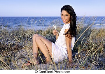 Beautiful brunette posing on the beach - Beautiful brunette...
